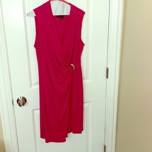 Pink wrap dress with gold ring on front